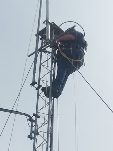 Rob (NR3O) on the tower attaching the new VHF antenna.