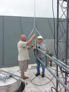 Jim W7ETE and Roger (KF7WVT) mount the new VHF APRS antenna to the horizontal frame.